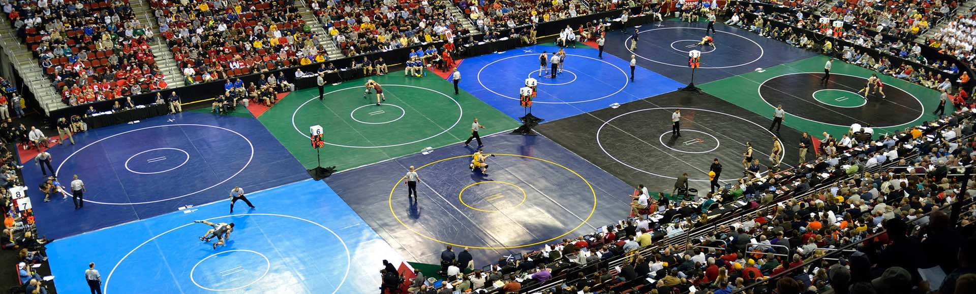 Photograph by George Tiedemann  2013 NCAA Division I Wrestling Championships in Des Moines, IA  The 2013 NCAA wrestling championships began with sparse crowds and eight mats for Session One. But by Saturday night, tickets for the one-mat national title matches were almost impossible to find.